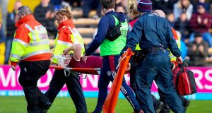 alway's Joe Canning leaves the field on a stretcher against Waterford. Photograph: Tommy Dickson/Inpho