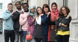 Emily Logan, Chief Commissioner of the Irish Human Rights and Equality Commission (3rd from right), with from left; Brian Doyle, Immanuel Jayden Chirwa, Kelvin Akpaloo, Fathi Mohamed, Christina Burlacu, Bushra Tanveer and Farah Elle. Photograph: Dara Mac Donaill / The Irish Times