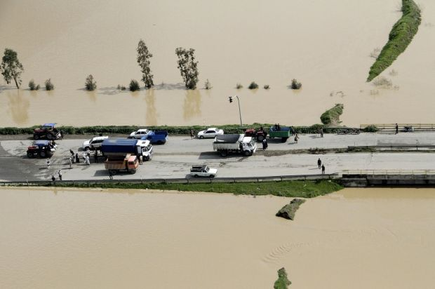 Vehicles trapped by floodwaters on a road in Golestan province, Iran on March 22nd. Photograph: Tasnim News Agency/Reuters