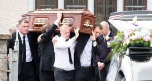 Kieran Downey  (right) helps carry the coffin   bearing the remains of his wife Marie Downey and   son Darragh as it  leaves St Michael's Church, Ballyagran on Saturday afternoon.