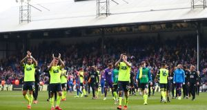 Huddersfield Town players applaud their fans after their defeat to Crystal Palace means they are relegated from the Premier League. Photograph: Reuters