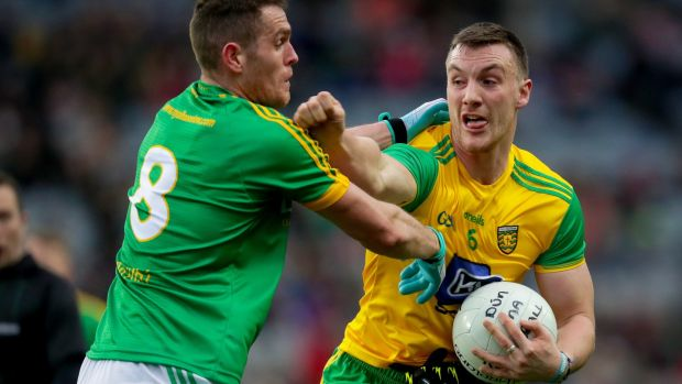 Donegal's Leo McLoone and Bryan Menton of Meath. Photograph: Oisin Keniry/Inpho