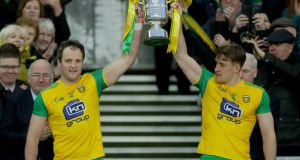 Donegal's Michael Murphy and Hugh McFadden lift the Division Two trophy. Photograph: Oisin Keniry/Inpho