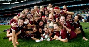 Galway celebrate their Camogie Division One final win over Kilkenny. Photograph: James Crombie/Inpho