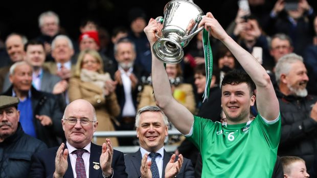 Declan Hannon with the trophy after Limerick beat Waterford in the Division One final. Photograph: Ryan Byrne/Inpho