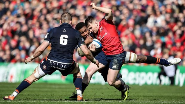 Munster's Rory Scannell is tackled by Edinburgh's Viliame Mata and John Barclay. Photograph: Dan Sheridan/Inpho