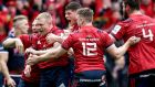 Munster's Keith Earls celebrates scoring their first try with teammates in the province's narrow Champions Cup quarter-final win over Edinburgh in  Murrayfield Stadium, Scotland. Photograph: Dan Sheridan/Inpho