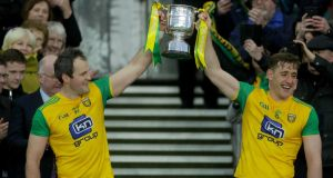 Donegal's Michael Murphy and Hugh McFadden lift the Allianz Football League Division 2 title trophy after beating Meath. Photograph: Oisin Keniry/Inpho