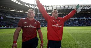Munster head coach Johann van Graan and CJ Stander celebrate  their 7-13 Champions Cup victory over Edinburgh at Murrayfield.  Photograph:  ©INPHO/Dan Sheridan