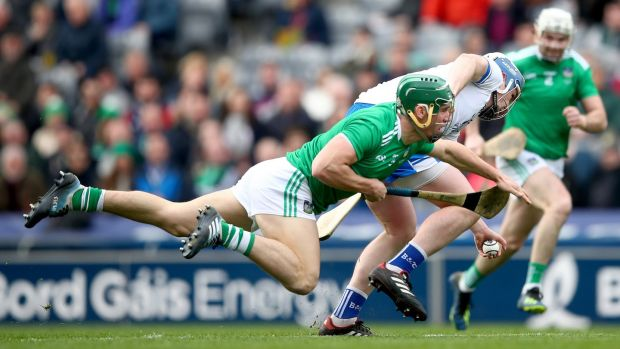Limerick's Sean Finn and Stephen Bennett of Waterford tussle for the ball. Photo: James Crombie/Inpho