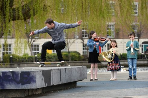 STREET ENTERTAINMENT: Chloe O'Connor (12), of Clonskeagh, Con Moynihan (8), of Glasthule, and Amaris Condria (4), of Ballsbridge, members of the Royal Irish Academy of Music, with skateboarder Anto Thornberry, at a photocall to mark the launch of the programme for Musictown 2019, running from April 5th to 21st.  Photograph: Dara Mac Donaill