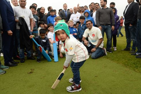 THAT'S CRICKET: Taoiseach Leo Varadkar (centre background) joins club members for a team snap as Rishian Madhikanti (2), prepares to bat at the opening ceremony for the Tyrrelstown Cricket Club in Tyrrelstown Park, Dublin. Photograph: Dara Mac Donaill