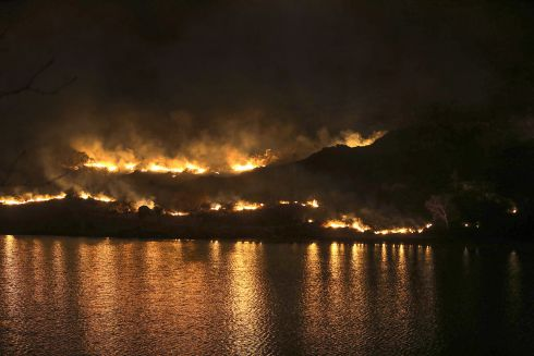 TINDER BOX: Kerry County Council fire crews deal with mountain gorse blazes at Looscaunagh Lake and mountainside in Killarney National Park in Co Kerry. The mountain has been closed until further notice. Photograph: Valerie O'Sullivan