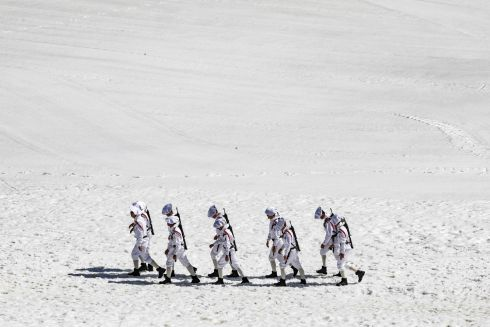 RESISTANCE TRIBUTE: Elite French army infantry soldiers known as Chasseurs Alpins (Alpine Hunters) walk in snow during a ceremony in tribute to second World War resistance fighters killed at the Plateau des Glieres, near Thorens-Glieres in the French Alps. Photograph: ludovic Marin/AFP/Getty