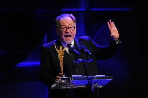 Owen Roe addresses the audience upon accepting his Special Tribute Award at the The Irish Times Irish Theatre Awards at the National Concert Hall. Photograph: Aidan Crawley