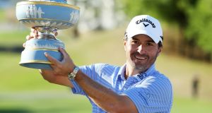 Kevin Kisner celebrates his victory in Texas. Photograph: Warren Little/Getty