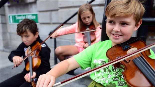 Patrick Connolly (10), Yvie Sharkey (9) and Tommy Sweeney (10) from Clogherhead, Co Louth, at the Fleadh Cheoil Na hEireann in Drogheda last August. Photograph: Bryan O'Brien