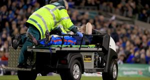Leinster's Dan Leavy is taken off the pitch after injuring his knee during the Champions Cup win over Ulster. Photograph: Donall Farmer/PA
