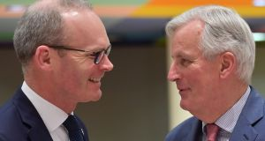 European chief Brexit negotiator Michel Barnier with  Simon Coveney:  The aura of competence that surrounds the Irish State when it is facing outwards evaporates when it is turned towards its own internal problems. Photograph: Emmanuel Dunand/AFP/Getty Images