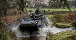 A Mowag tank crosses the Slaney during a mission readiness exercise in the Glen of Imall, Co Wicklow. Photograph: Brenda Fitzsimons