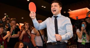 Ukrainian comic actor and presidential candidate Volodymyr Zelenskiy plays table tennis with a journalist ahead of the provisional results of the first-round vote in the election, in Kiev. Photograph: Genya Savilov/AFP/Getty Images