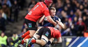 Leinster's Dan Leavy is tackled by Ulster's  Eric O'Sullivan and Billy Burns at the Aviva Stadium. Photograph: Billy Stickland/Inpho