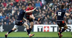 Munster's Joey Carbery and John Barclay of Edinburgh in their Heineken Champions Cup quarter-final match at Murrayfield on Saturday. Photograph: Dan Sheridan/Inpho