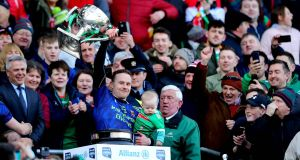 Mayo's Andy Moran lifts the Allianz League Division One trophy. Photo: Ryan Byrne/Inpho