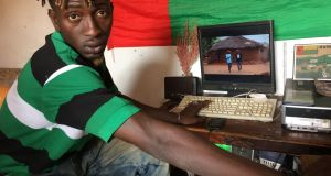 "Erickson da Silva (26), aka MC Rey, in his room in Bissau. ""We're in a country where the leaders are out for themselves,"" he says. ""But we're looking out for each other."" Photograph: Lorraine Mallinder"