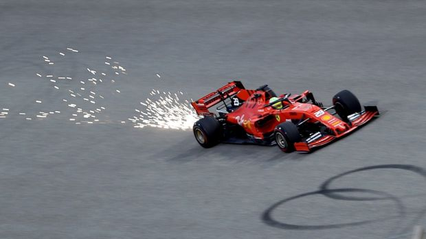 Sparks fly from the back of Mick Schumacher's Ferrari during testing in Bahrain. Photograph: Hamad I Mohammed/Reuters