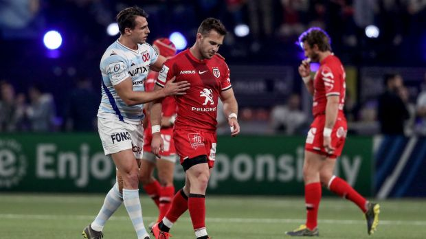 Toulouse's Zack Holmes is consoled by Juan Imhoff of Racing after being red carded for a dangerous high tackle during the Champions Cup quarter-final in Paris. Photograph: Dan Sheridan/Inpho
