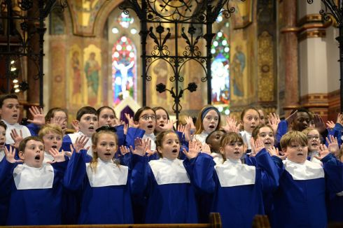 HANDS UP: Students from  St Molagas SNS, Balbriggan, Co Dublin, perform during the Feis Ceoil Junior Choirs   Unison competition at St Bartholomew's Church, Ballsbridge, Dublin. Photograph: Dara Mac Donaill/The Irish Times