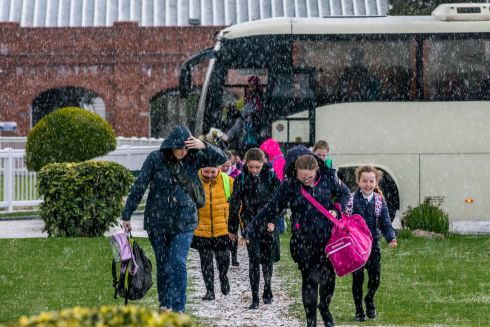 CHOIR GIRLS: Tullamore Stage School members make their way through hail at the ESB Feis Ceoil School Choir of the Year competition at the RDS, Dublin. Photograph: Clare Keogh