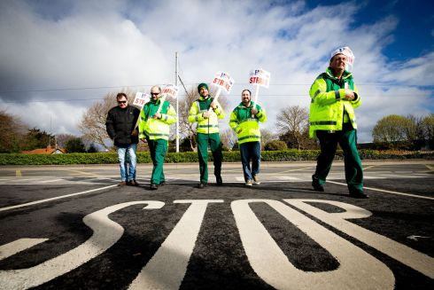 STRIKE ON HERE: Ambulance workers take part in a picket over union representation rights outside an ambulance station on Dublin's Davitt Road. Photograph: Tom Honan
