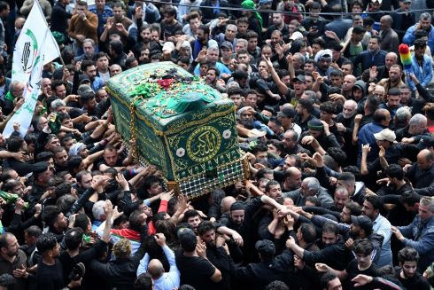 IMAM HONOURED: Shia worshippers carry a coffin marking the anniversary of the death of  Imam Mousa al-Kadhim, who died in the 8th century AD, at his shrine in the Kadhimiyah district of Baghdad, Iraq. Iraqi security forces imposed tight security. Photograph: Murtaja Lateef/EPA