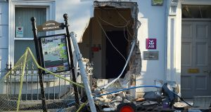 The scene in Castleblayney, Co Monaghan, where a digger was used to pull a cash machine from a wall during a theft. Photograph: Philip Fitzpatrick