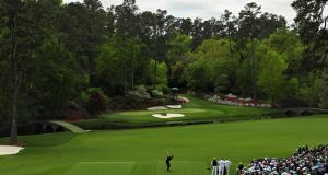 Tiger Woods tees off at the Par 3 12th at Augusta National in 2018. Photograph: Patrick Smith/Getty