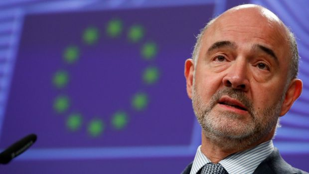 European Commissioner for Economic and Financial Affairs Pierre Moscovici holds a news conference in Brussels. Photograph: Francois Lenoir/Reuters