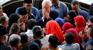 Malaysia's former prime Minister, Najib Razak, offers a prayer as he arrives at the high court in Kuala Lumpur on Wednesday. Photograph: Lai Seng Sin/Reuters