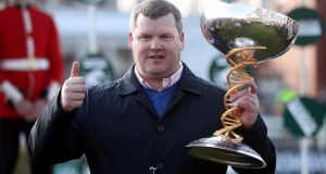 Gordon Elliott celebrates Tiger Roll's success in the Grand National at Aintree last year.  Photograph:  David Davies/PA