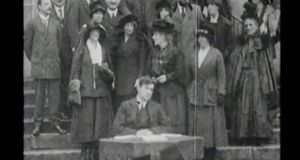 Michael Collins at the launch of the Dáil loan, surrounded by many prominent figures from the Irish revolution including the mother of Patrick Pearse and the widows of Tom Clarke and Eamon Ceannt. Source: Irish Film Institute