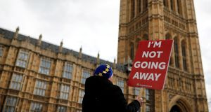An anti-Brexit protester demonstrates outside the Houses of Parliament in London