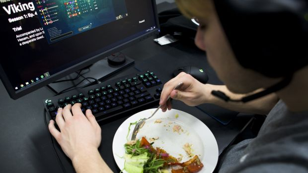 Patrik Jíru finishes a dinner of salmon and vegetables at his desk during Team Origen's scrimmages at Rfrsh Entertainment's offices in Copenhagen. Photograph: Pete Kiehart/ The New York Times