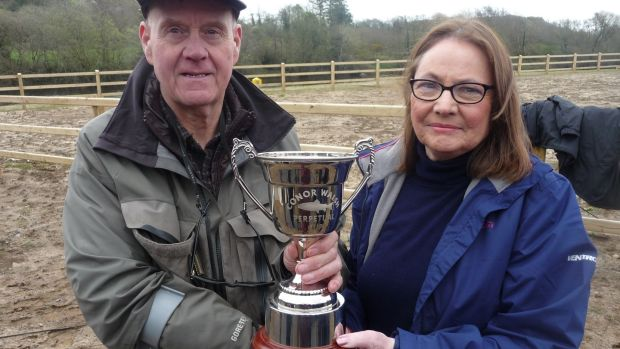 Bob Mayne receiving the Conor Walsh Memorial Cup from Marie Holmes Walsh for his catch of the first salmon on EMAA waters of 2019