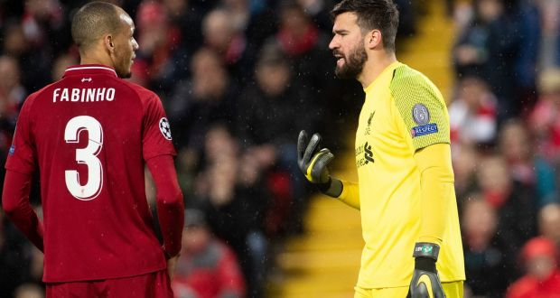 62aa045a2d4b Liverpool s Fabio Henrique speaks with goalkeeper Alisson Becker during the  Champions League round of 16 match