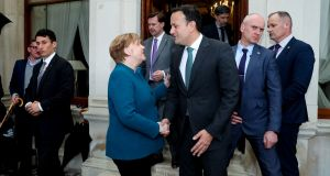 "German chancellor Angela Merkel shakes hands with Taoiseach Leo Varadkar as she leaves Farmleigh House: the visit was ""the message"". Photograph:  Maxwellphotography.ie/Pool"