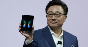 DJ Koh, Samsung president, holds up the Galaxy Fold smartphone during an event in February.