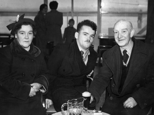My Left Foot: Christy Brown at Dublin Airport with his parents, in October 1954, before leaving for London