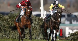 Davy Russell riding Tiger Roll (left) clears the last to win The  Grand National Handicap Steeple Chase from Pleasant Company and David Mullins  at Aintree last year. Photograph:  Alan Crowhurst/Getty Images