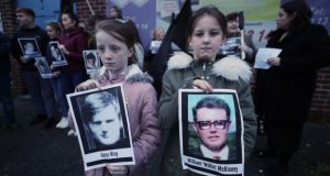 Children hold pictures of  Bloody Sunday victims  during a vigil in Belfast last month. Photograph: Niall Carson/PA Wire